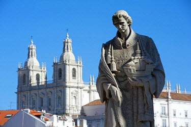 POR9132 Portugal, Lisbon. Backed by the Church of S�o Vicente de Fora, a statue of Lisbon's patron saint - Saint Vincent of Saragossa, or Saint Vincent of Fora, in the Alfama district.