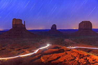 HMS1389254 United States, Arizona, Navajo Nation Indian Reservation, Monument Valley Tribal Park, startrails over the Mitten Buttes