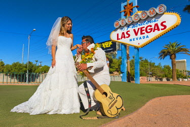 United States, Nevada, the Strip, Las Vegas sign on Las Vegas Boulevard, newly wed with Elvis Presley