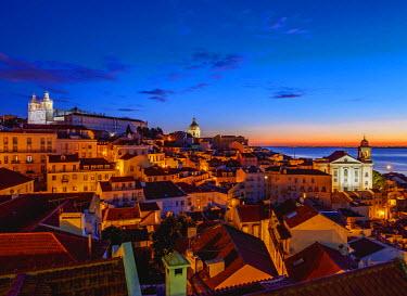 POR9199AW Portugal, Lisbon, Miradouro das Portas do Sol, View over Alfama Neighbourhood at sunrise.