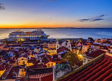 POR9201AW Portugal, Lisbon, Miradouro das Portas do Sol, Twilight view over Alfama Neighbourhood towards the Tagus River.