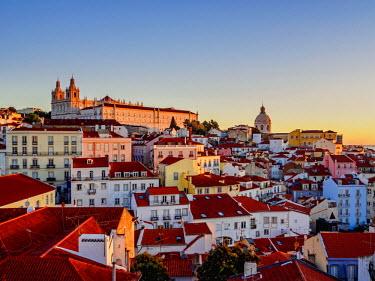 POR9204AW Portugal, Lisbon, Miradouro das Portas do Sol, View over Alfama Neighbourhood towards the Sao Vicente de Fora Monastery and National Pantheon at sunrise.