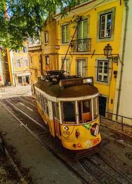 POR9224AW Portugal, Lisbon, Typical tram in Alfama.