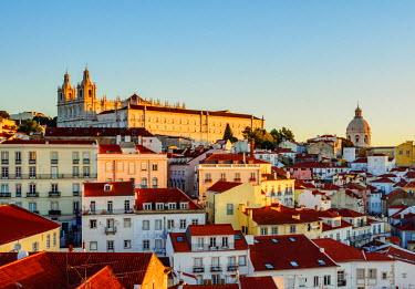 POR9273AWRF Portugal, Lisbon, Miradouro das Portas do Sol, View over Alfama Neighbourhood towards the Sao Vicente de Fora Monastery and National Pantheon at sunrise.