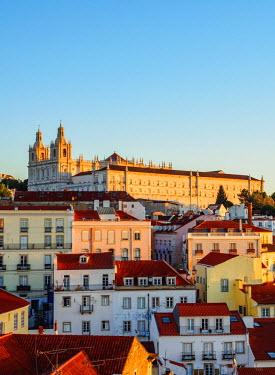 POR9274AWRF Portugal, Lisbon, Miradouro das Portas do Sol, View over Alfama Neighbourhood towards the Monastery of Sao Vicente de Fora at sunrise.