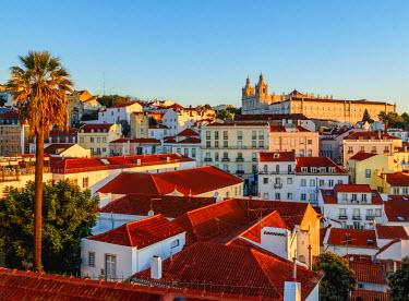 POR9275AWRF Portugal, Lisbon, Miradouro das Portas do Sol, View over Alfama Neighbourhood towards the Monastery of Sao Vicente de Fora at sunrise.