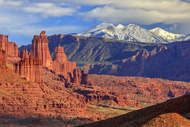 HMS2061632 United States, Utah, Colorado Plateau, State Route 128 (SR-128), Fisher Towers rock formations and the La Sal mountains in the background near Moab