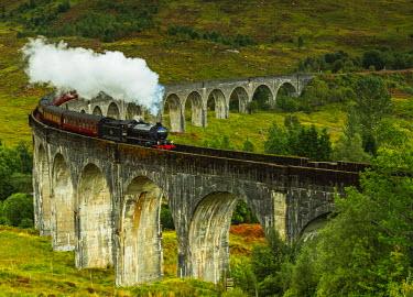 SCO34565AW UK, Scotland, Highlands, Jacobite Steam Train crossing the Glenfinnan Viaduct.