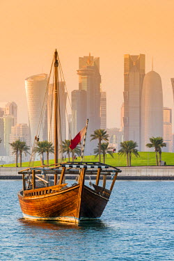 QAT0020AW Dhow traditional sailing vessel with the financial area skyline behind, Doha, Qatar
