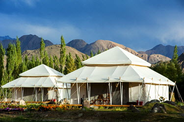 IND8263 India, Jammu & Kashmir, Ladakh, Thiksey. Spacious luxury tents at the Ultimate Travelling Camp offer unrivalled comfort in the Indus Valley.