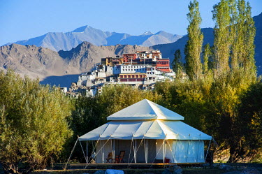 IND8276 India, Jammu & Kashmir, Ladakh, Thiksey. In the vicinity of Thiksey Monastery, spacious luxury tents at the Ultimate Travelling Camp offer unrivalled comfort in the Indus Valley.