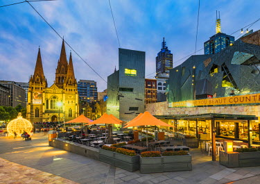AUS2814AW Melbourne, Victoria, Australia. Federation Square and St Paul's Cathedral at dusk.