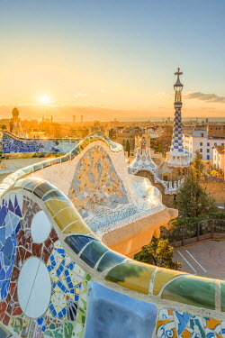 SPA7178AW Barcelona, Catalonia, Spain, Southern Europe. Unique Antoni Gaudi's architecture of Park Guell at sunrise.