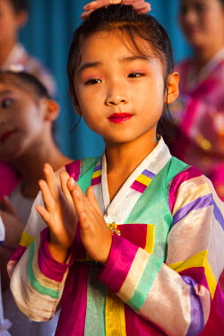 NKO0279 A talented child clapping at the Chongam Kindergarten in Chongjin, North Korea