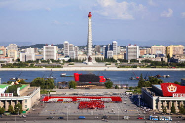 NKO0334 Practising for the 70th Anniversary of the ruling Workers' Party in Kim Il Sung Square, with the Juche Tower as backdrop, North Korea