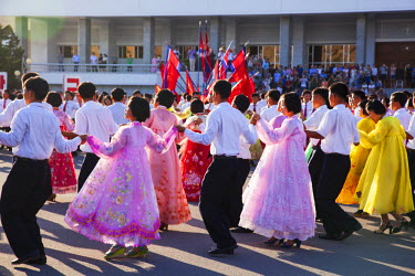 NKO0356 Students engaging in a mass dance in front of the Indoor Stadium, North Korea