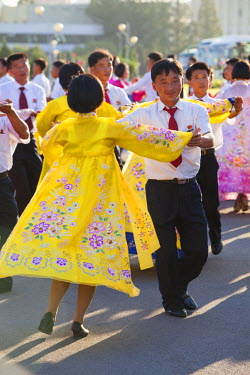 NKO0360 Students engaging in a mass dance in front of the Indoor Stadium, North Korea