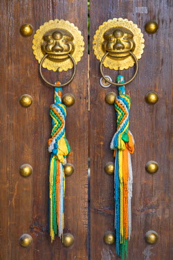 Door of guesthouse, Lijiang (UNESCO World Heritage Site), Yunnan, China