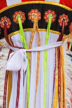 CH10907AW Naxi woman wearing traditional clothing, Lijiang (UNESCO World Heritage Site), Yunnan, China