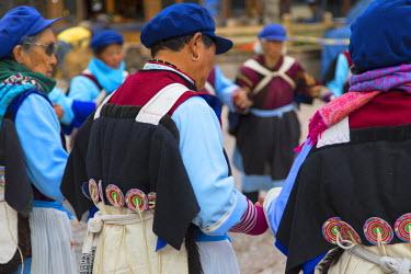 CH10913AW Naxi women wearing traditional clothing performing dance, Lijiang (UNESCO World Heritage Site), Yunnan, China