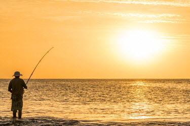 CVE0110AWRF africa, Cape Verde, Santiago. A fisherman at sunset in Tarrafal