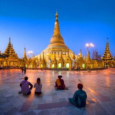 Tourists praying at the Shwedagon Pagoda in Yangon, Yangon Region, Myanmar