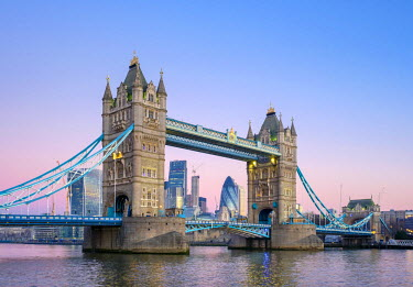 ENG14289AWRF United Kingdom, England, London. Tower Bridge over the River Thames and skyline of central London at dawn.