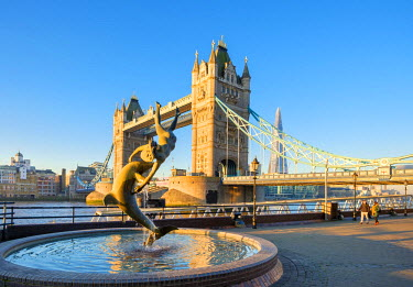 ENG14270AW United Kingdom, England, London. Tower Bridge and 'Girl With a Dolphin' fountain at sunrise.