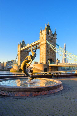 ENG14271AW United Kingdom, England, London. Tower Bridge and 'Girl With a Dolphin' fountain at sunrise.