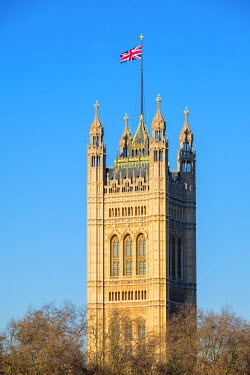ENG14304AWRF United Kingdom, England, London. Union Jack flag flown above Victoria Tower, Palace of Westminster, the houses of Parliament of the United Kingdom.