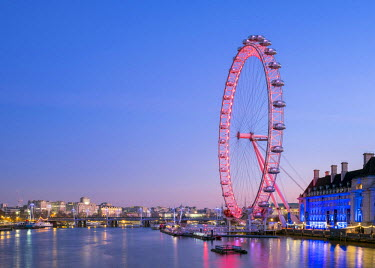 ENG14306AWRF United Kingdom, England, London. London Eye observation wheel on the River Thames at dawn.