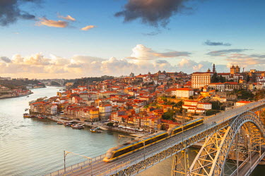 CLKAB53822 Porto at sunset with a train on Louis I 8 bridge on Douro River. Oporto city, Porto district, Portugal, Europe