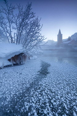 CLKRM52209 The frozen river Inn framed by mist and snow at dawn Sils Canton of Graubunden Engadine Switzerland Europe
