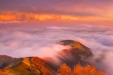 CLKAB52590 The sunset above the clouds over Prealpi Orobiche. Bronzone Mount (Prealpi Orobiche). Viadanica, Bergamo province, Lombardy, Italy, Europe