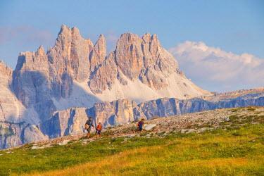 CLKAB53198 Family excursion in Dolomiti near Cinque Torri. Cortina d'Ampezzo, Belluno Province, Veneto District, Italy, Europe