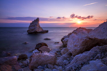 CLKRM51794 Cliffs and sea framed by the pink sky at sunrise La Vela Beach Portonovo province of Ancona Conero Riviera Marche Italy Europe