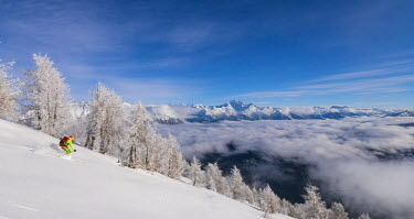 CLKRS54479 Skier over the clouds at Cima della Rosetta, Valgerola, Valtellina, Lombardy, Italy, Alps