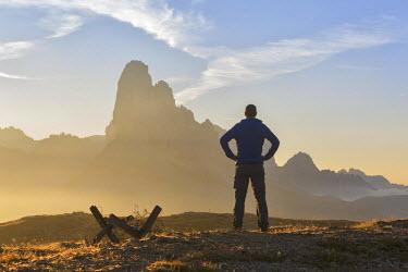 CLKMG50792 Europe, Italy, Veneto, Belluno, Cadore, Auronzo.  A man near the trenches of World War I on Monte Piana admires the Tre Cime di Lavaredo at sunrise