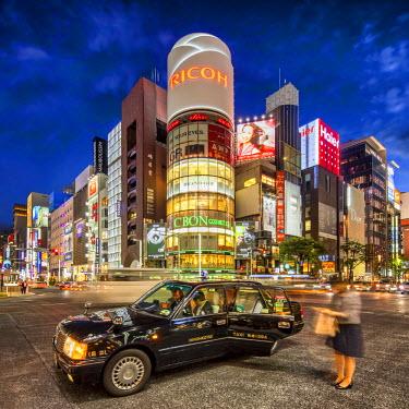 JAP1122AW Crossing street at night, Ginza, Tokyo, Japan