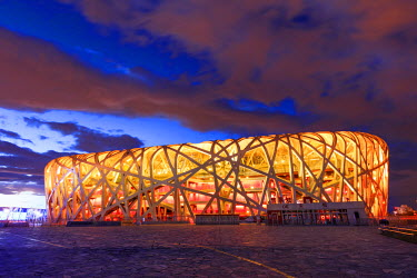 CH11262AW China, Beijing, Olympic park and famous bird's nest stadium made of steel illuminated by a colorful sunset