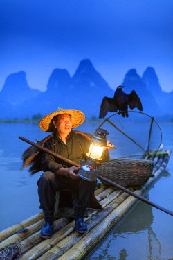 CH11314AW China, Guangxi province, Xingping village along River Li. Traditional cormorant fisherman by night on the Li river