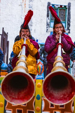 NEP2103AW Local monks with ceremonial dress playing tibetan horns during a festival,  Lo Manthang, Upper Mustang region, Nepal