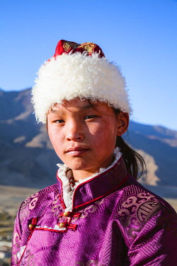 TIB0169AW Young tibetan girl with traditional dress, Samye monastery, Tibet, China (MODEL RELEASED)