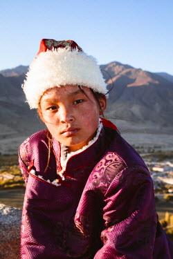 TIB0170AW Young tibetan girl with traditional dress, Samye monastery, Tibet, China (MODEL RELEASED)