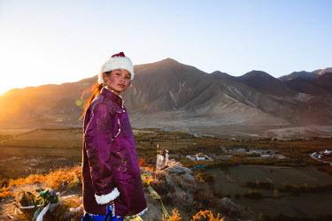 TIB0172AW Young tibetan girl with traditional dress, Samye monastery, Tibet, China (MODEL RELEASED)