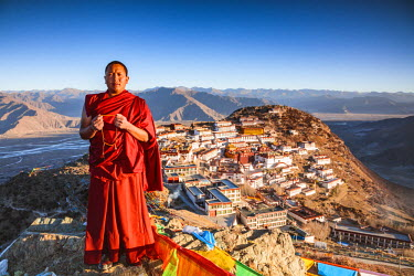 TIB0196AW Buddhist monk praying in front of Ganden monastery, Tibet, China (MODEL RELEASED)