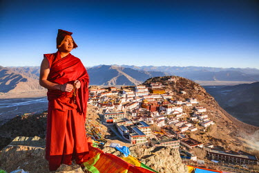 TIB0198AW Buddhist monk praying in front of Ganden monastery, Tibet, China (MODEL RELEASED)