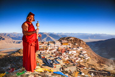 TIB0199AW Buddhist monk praying in front of Ganden monastery, Tibet, China (MODEL RELEASED)