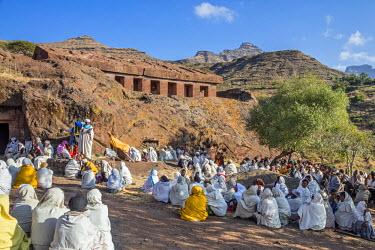 ETH3159 Ethiopia, Amhara Region, Lalibela, Genetta Maryam.  A open-air church service outside the ancient rock-hewn church of Genetta Maryam, an hour's drive from Lalibela.