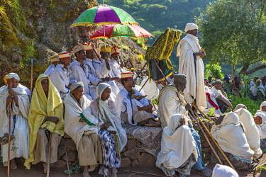 ETH3164 Ethiopia, Amhara Region, Lalibela, Genetta Maryam.  An open-air church service outside the ancient rock-hewn church of Genetta Maryam, an hour's drive from Lalibela.